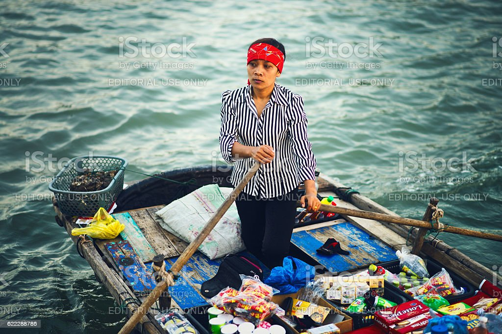 Unidentified woman sells fruits stock photo