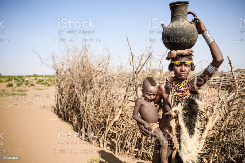 Unidentified woman with child from Deesenach tribe, Omo Valley, Ethiopia stock photo