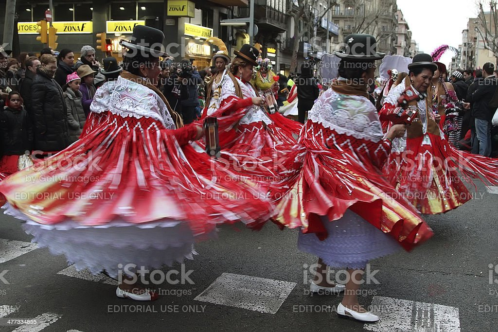 Unidentified women dress up dancing in Sants Street royalty-free stock photo