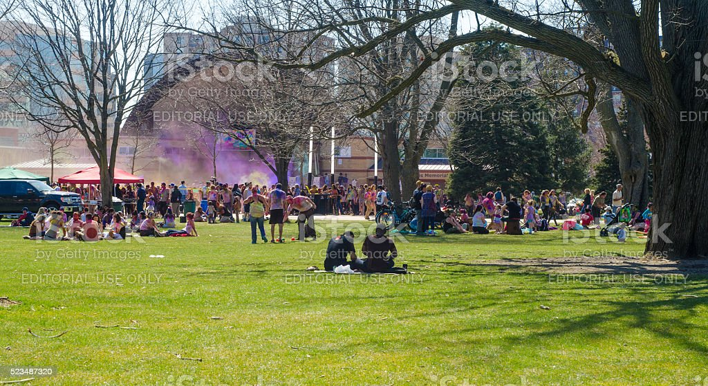 Unidentified young colorful people celebrating the Festival of Colour stock photo