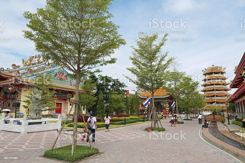 People walk by the Dragon Descendants park, Suphan Buri, Thailand. stock photo