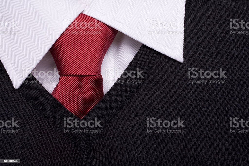 Uniform black pullover, red tie and white shirt stock photo