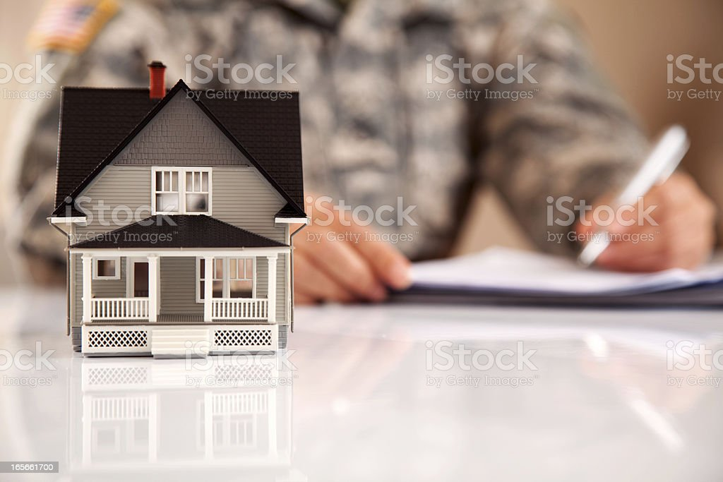 Uniformed Personel with Real Estate Paperwork stock photo