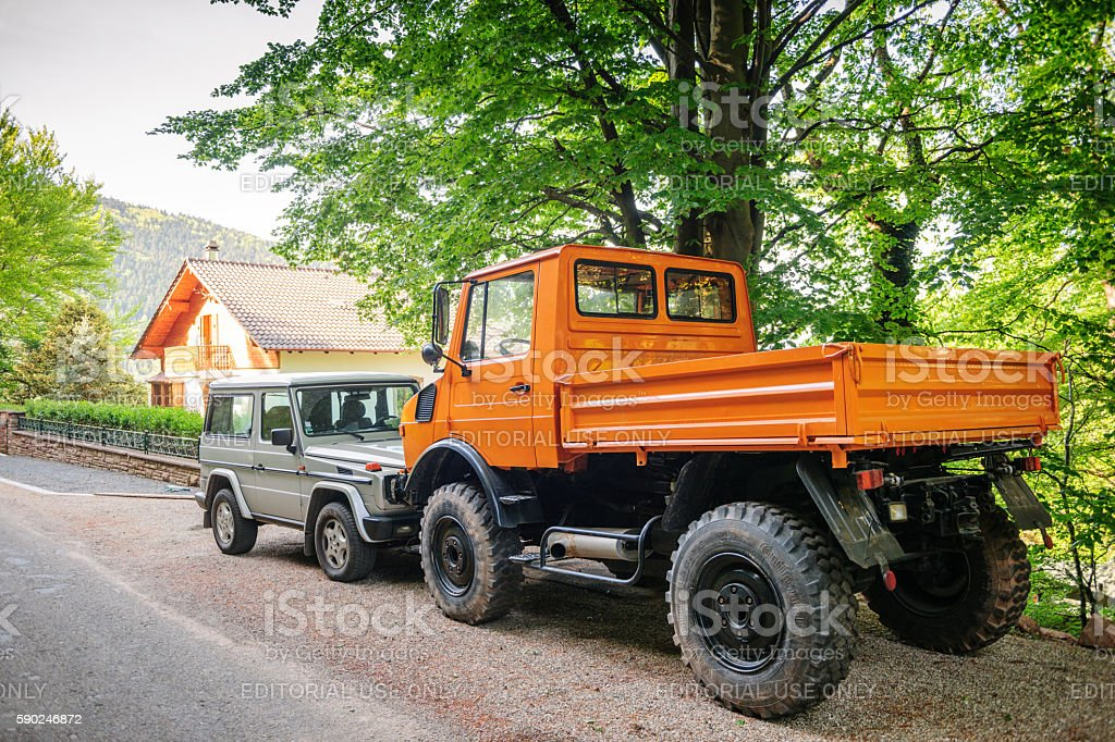 Unimog and Mercedes-Benz G Class SUV stock photo
