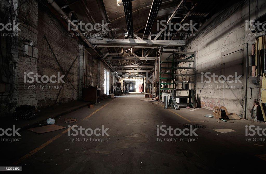 Uninviting and dark warehouse hall royalty-free stock photo
