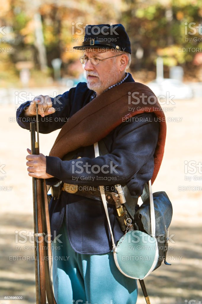 Union Army Civil War Reenactor Demonstrates Musket Loading stock photo