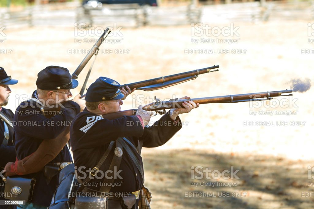 Union Army Civil War Reenactors Shoot Muskets In Firing Demonstration stock photo