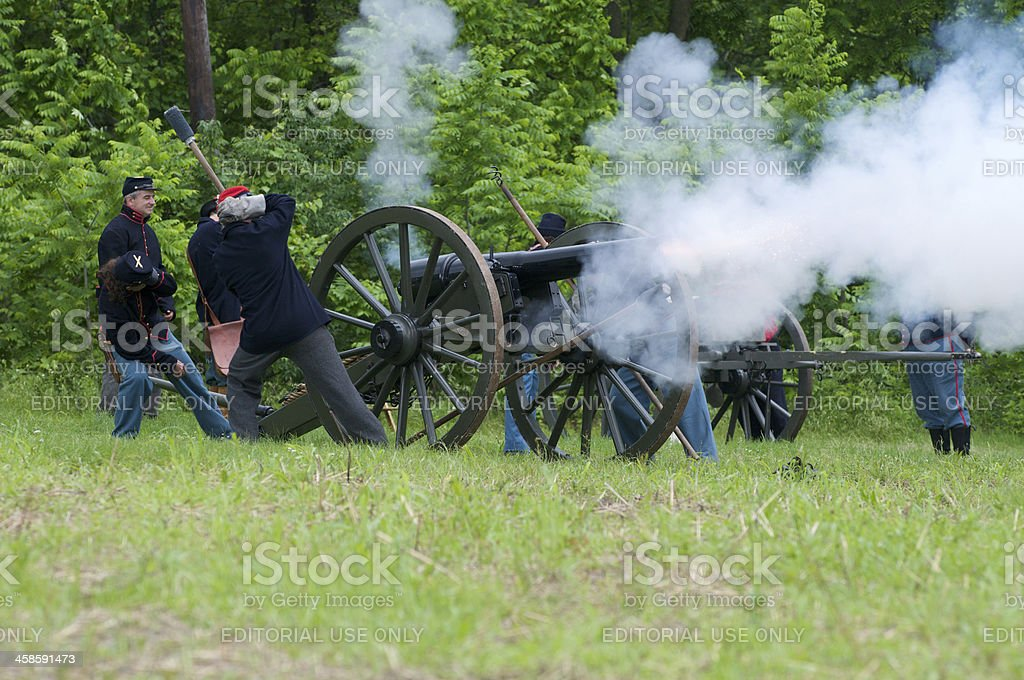 Union Civil War Renactors Fire a Canon at Confederate Troops royalty-free stock photo