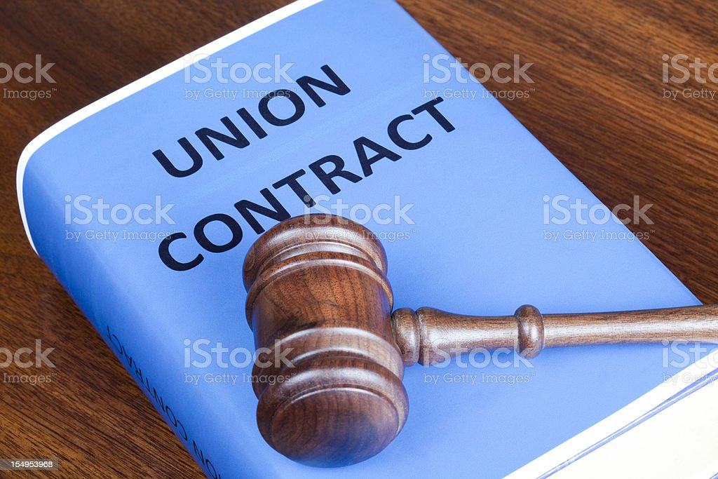Union contract and judge's gavel stock photo