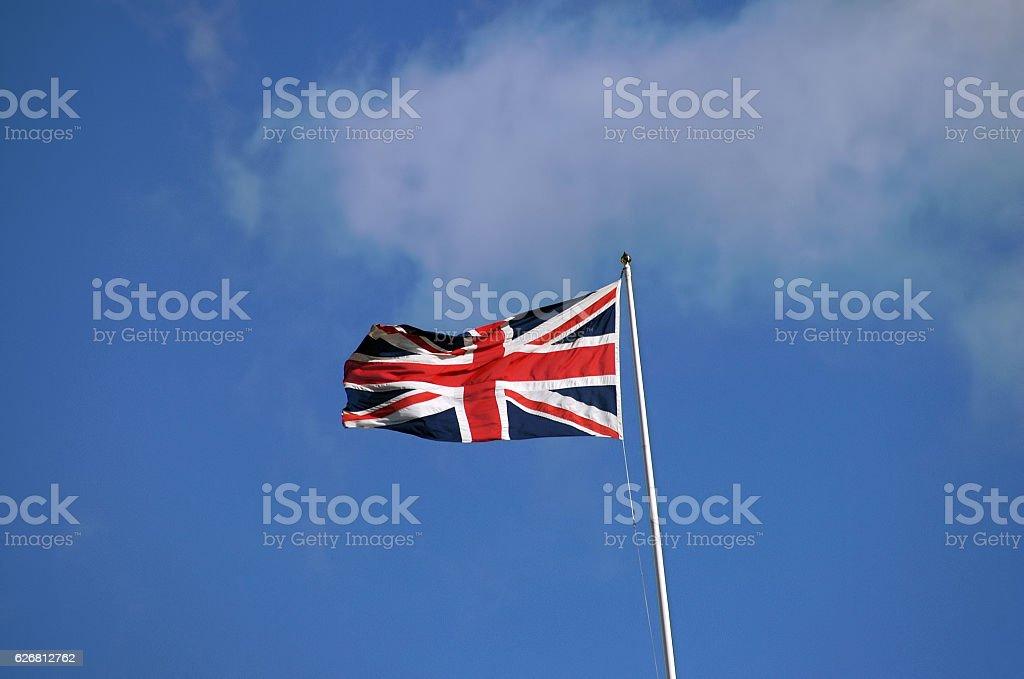 Union Jack, British flag and blue sky stock photo