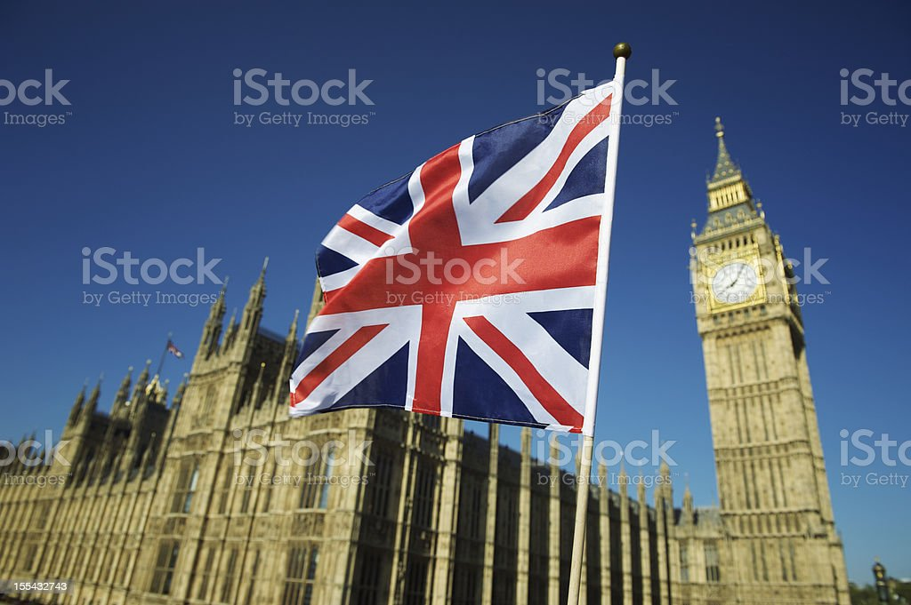 Union Jack British Flag Flies at Houses of Parliament London stock photo