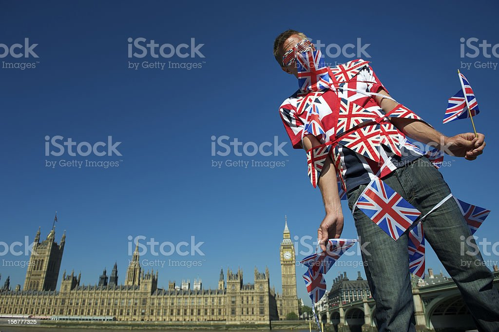 Union Jack Bunting Overload Guy Stands at Big Ben London stock photo