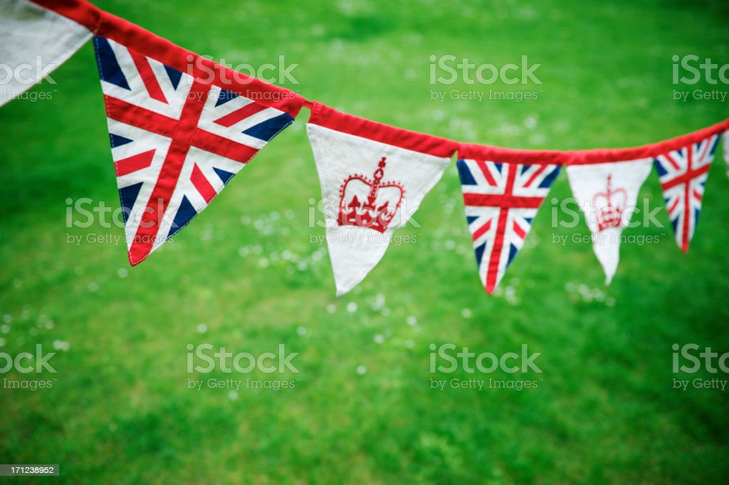 Union Jack Crown Celebratory Bunting Green Grass Royal Baby Decoration stock photo