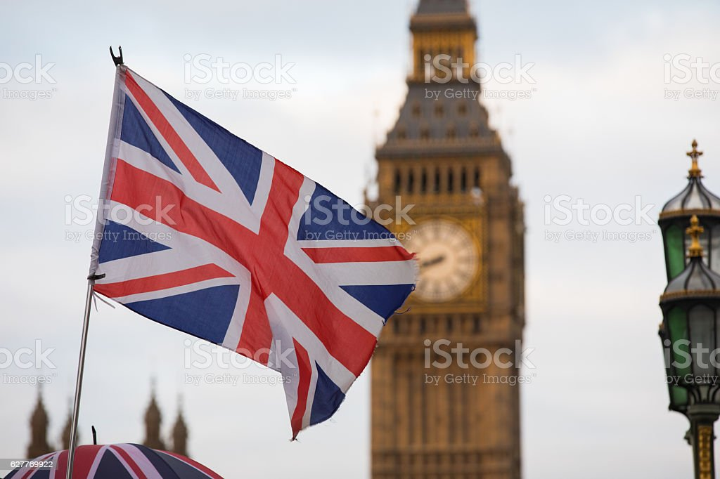 Union Jack flag and Big Ben in background stock photo