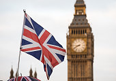 Union Jack flag and Big Ben in background