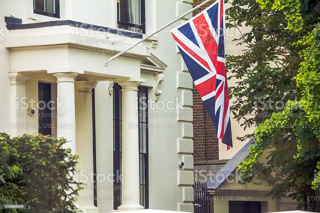 Union Jack Flag flying from a flag pole. London, UK stock photo