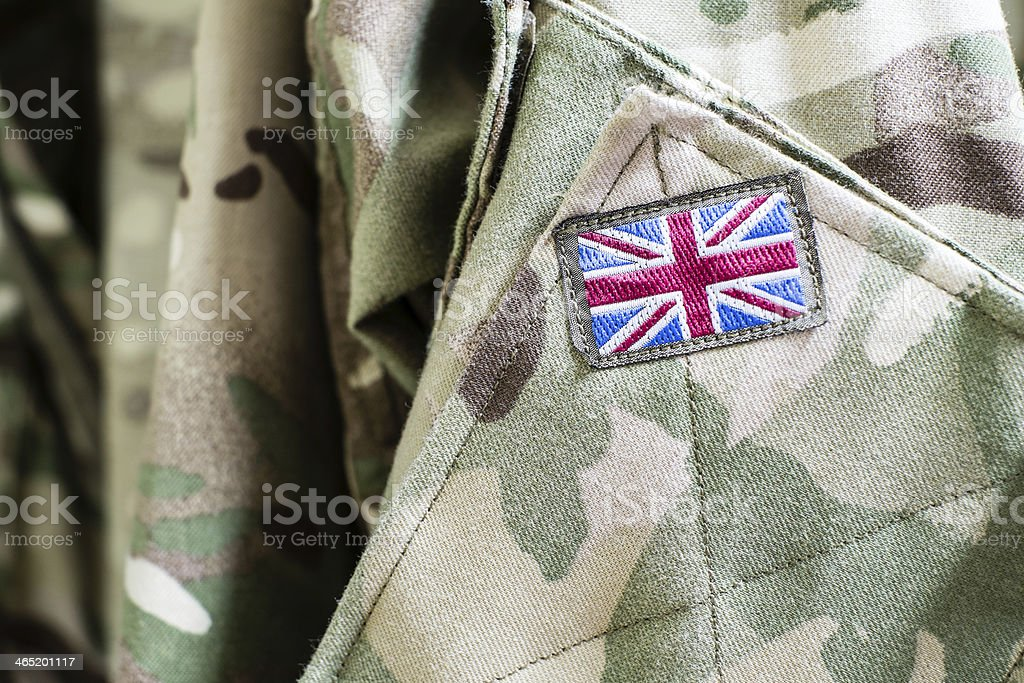 Union Jack flag on sleeve of British military camouflage uniform stock photo