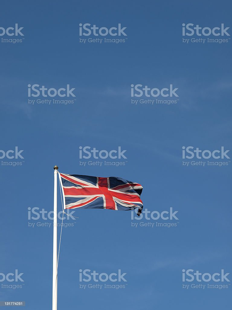Union Jack flying against a blue sky royalty-free stock photo