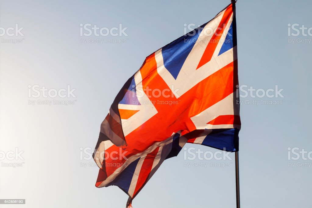 Union jack flying in the sky stock photo