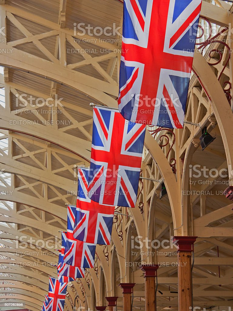Union jacks hanging in a hall prior to royal celebrations stock photo