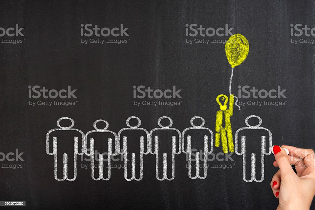 Unique businessman with a balloon stock photo