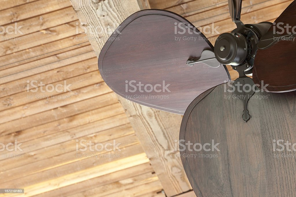 Unique Ceiling Fan and Wood Background royalty-free stock photo