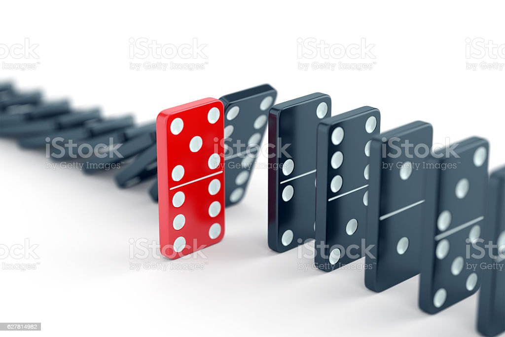 Unique domino tile among other dominoes stock photo