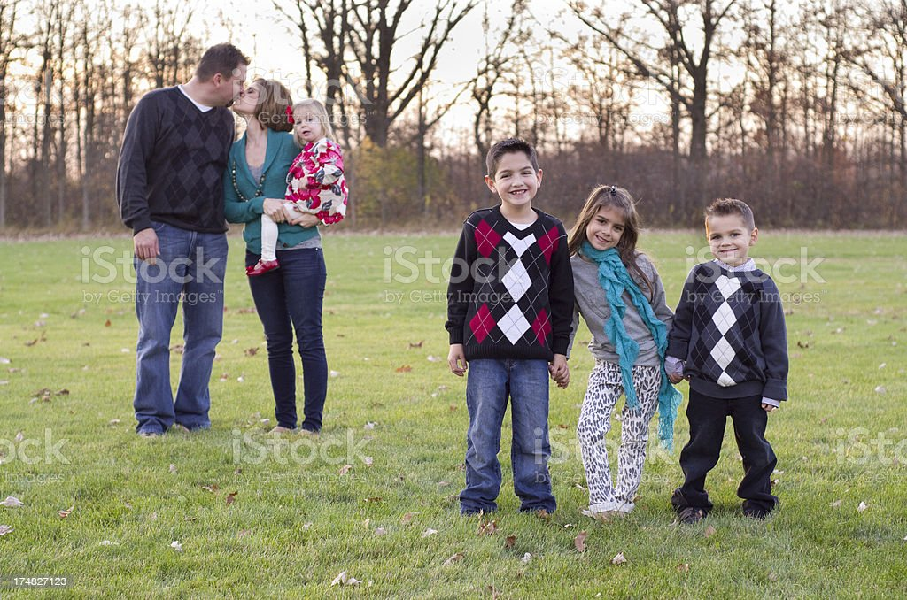 unique family picture with four kids royalty-free stock photo
