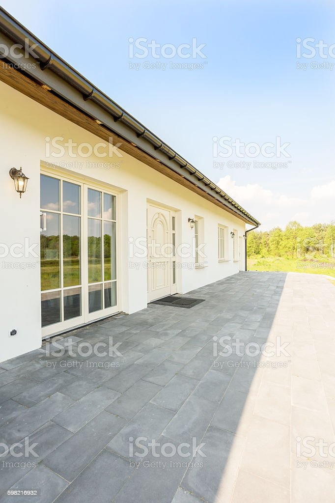 Unique one storey house in sunny surroundings stock photo