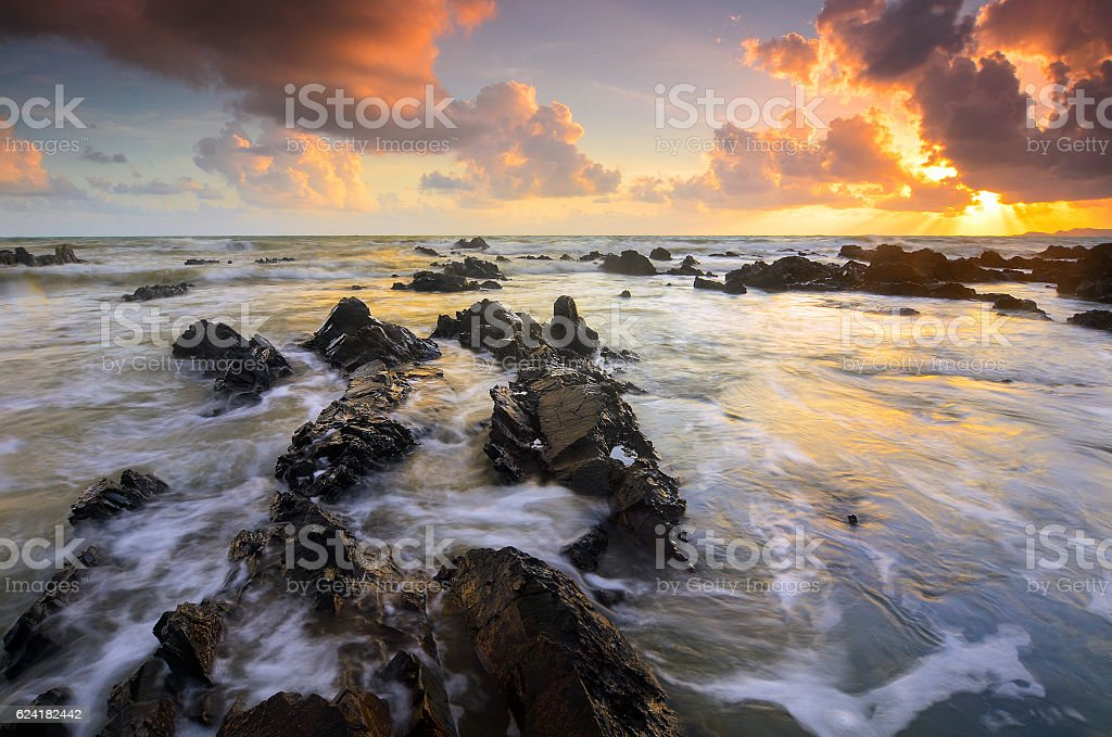 Unique rock formation hitted by wave stock photo