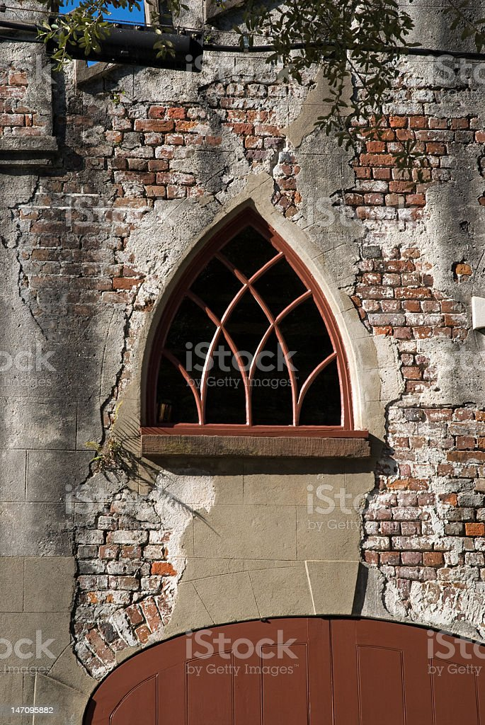 Unique Window on Old Brick Building royalty-free stock photo