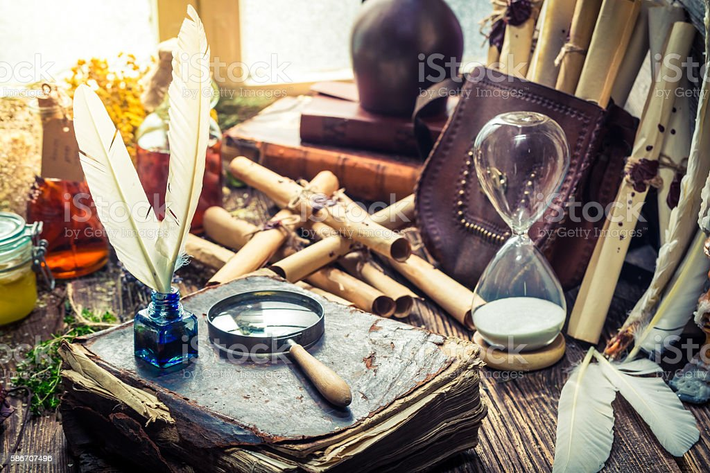 Unique witcher labolatory with scrolls and ingredients stock photo