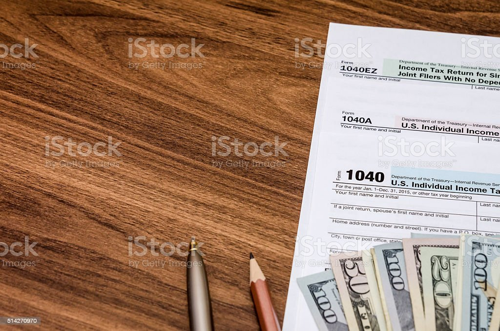 Unite States 1040 tax form with money on desk stock photo
