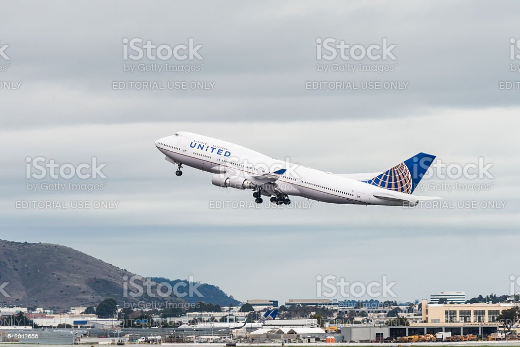 United Airlines airplane takeoff stock photo