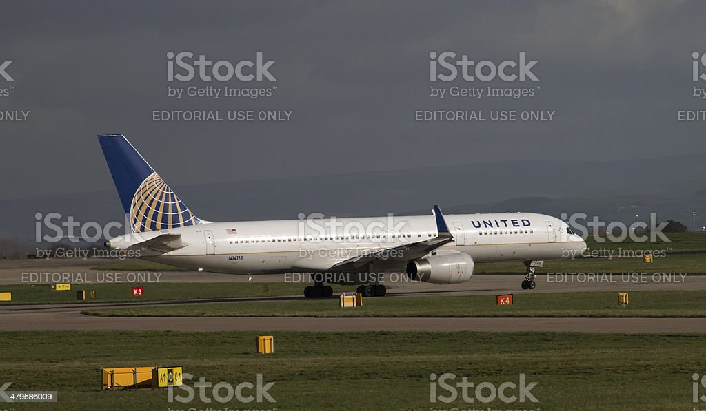 United Airlines Boeing 757 taxiing on Manchester Airport runway stock photo