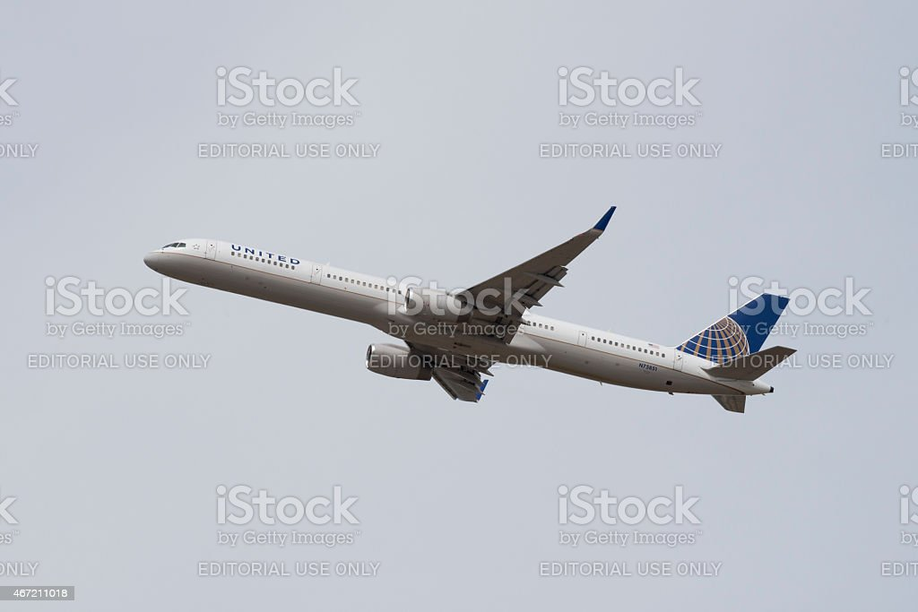 United Airlines Boeing 757-300 in flight stock photo