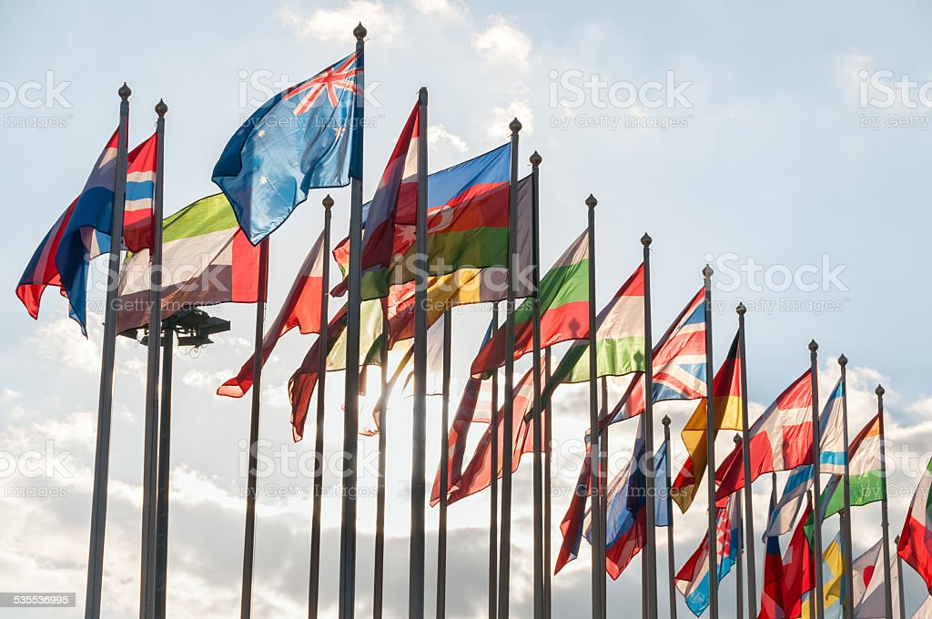 United Flags in backlit on blue sky background stock photo