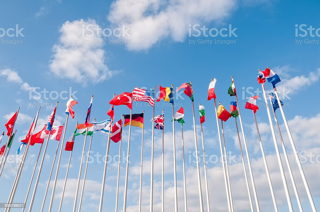 United Flags on blue sky background stock photo