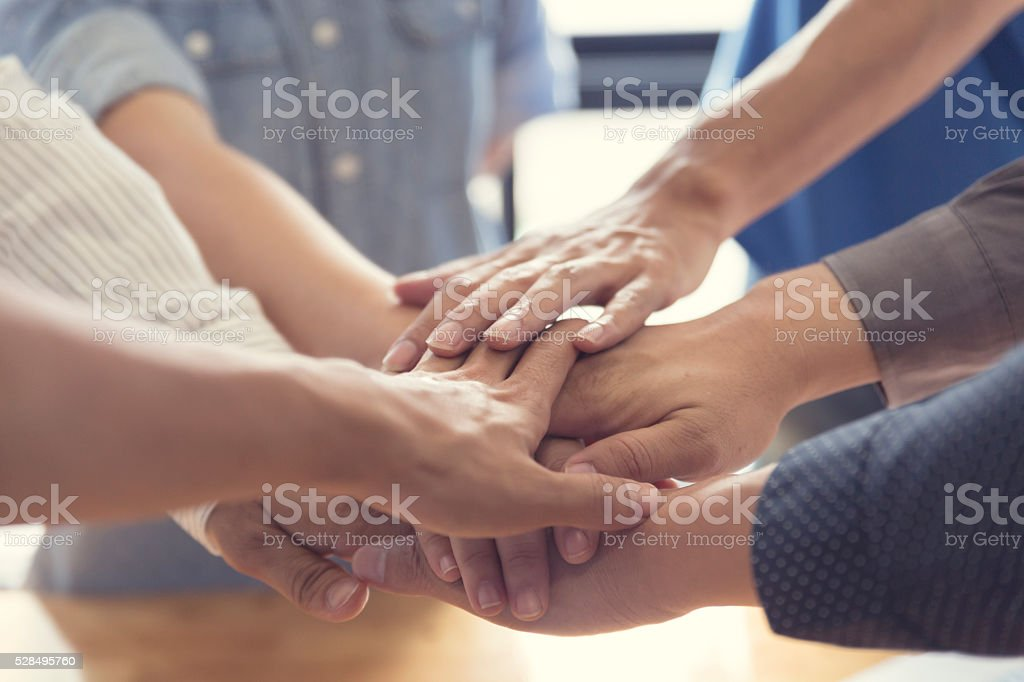 united hands for cooperation and teamwork concept stock photo