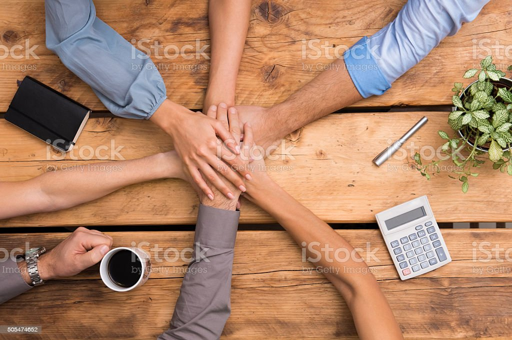 Closeup of business colleagues with their hands stacked. Business...