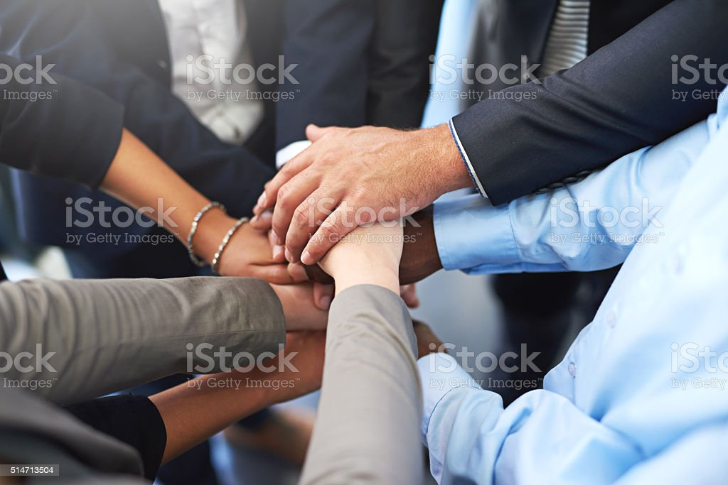 United in the pursuit of success stock photo