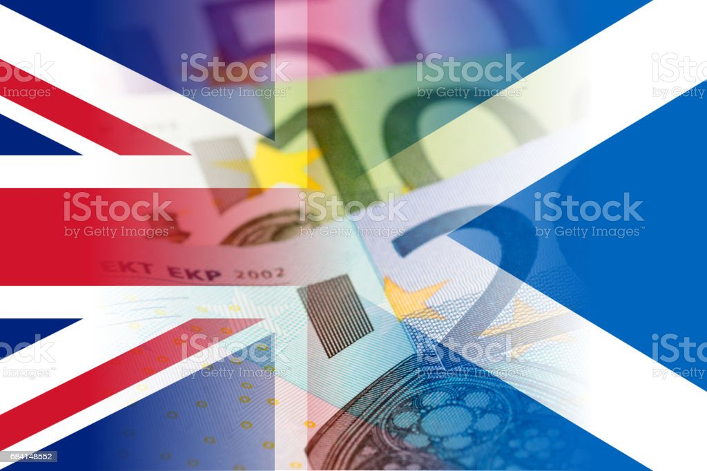 united kingdom and scotland flags with euro banknotes mixed image stock photo