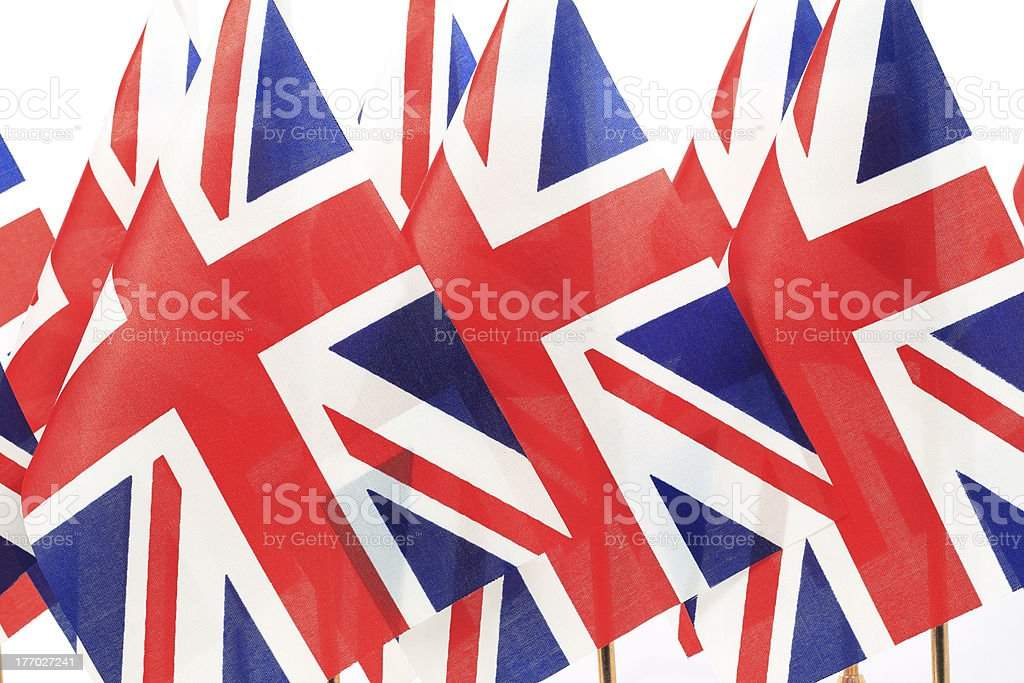 United Kingdom flags hanging in the queue on flagpole royalty-free stock photo