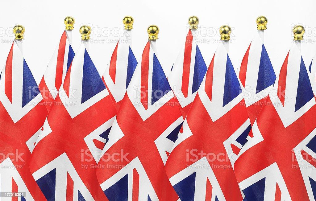 United Kingdom  flags hanging on the gold flagpole royalty-free stock photo