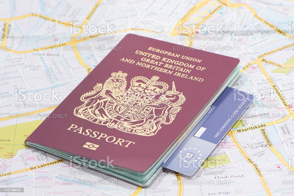 United Kingdom Passport and European Healthcard on map stock photo
