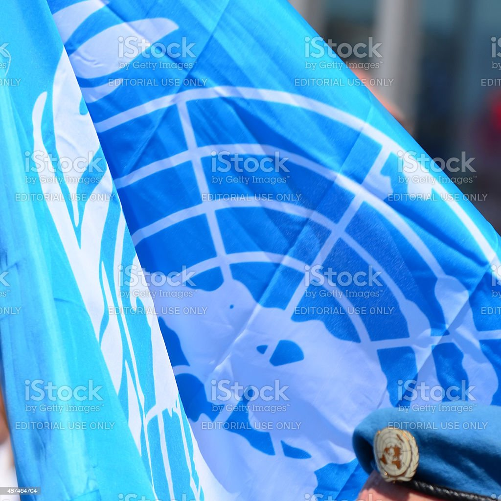 United Nations flag and beret stock photo