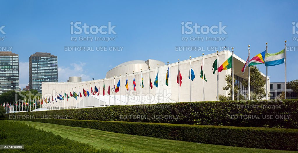 UN United Nations general assembly with world flags stock photo