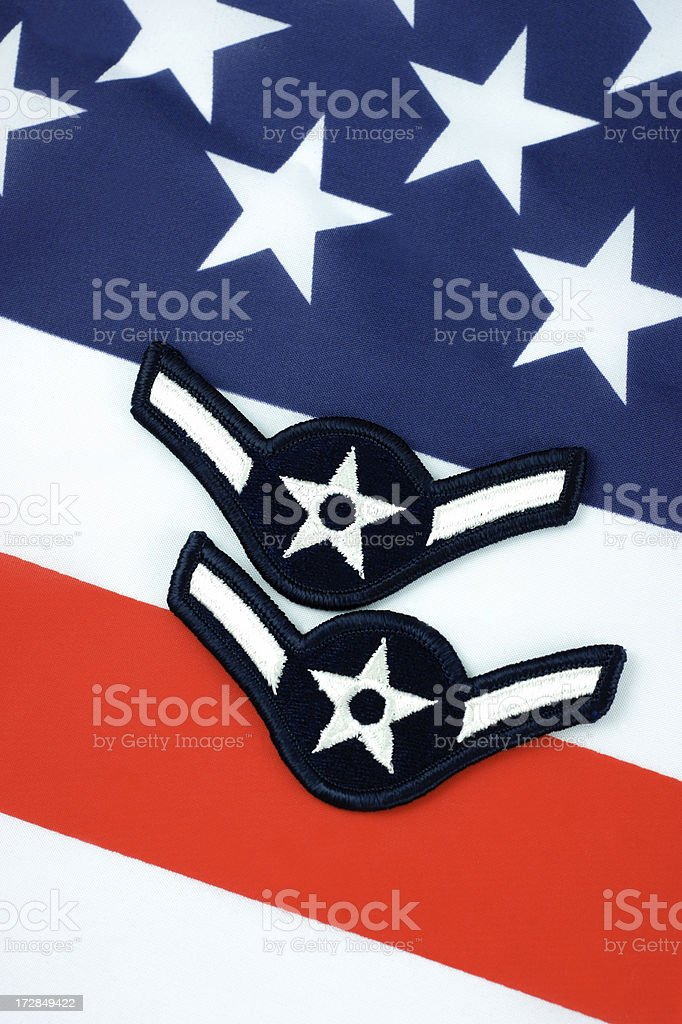 United States Air Force Airman Rank Insignia on Flag royalty-free stock photo
