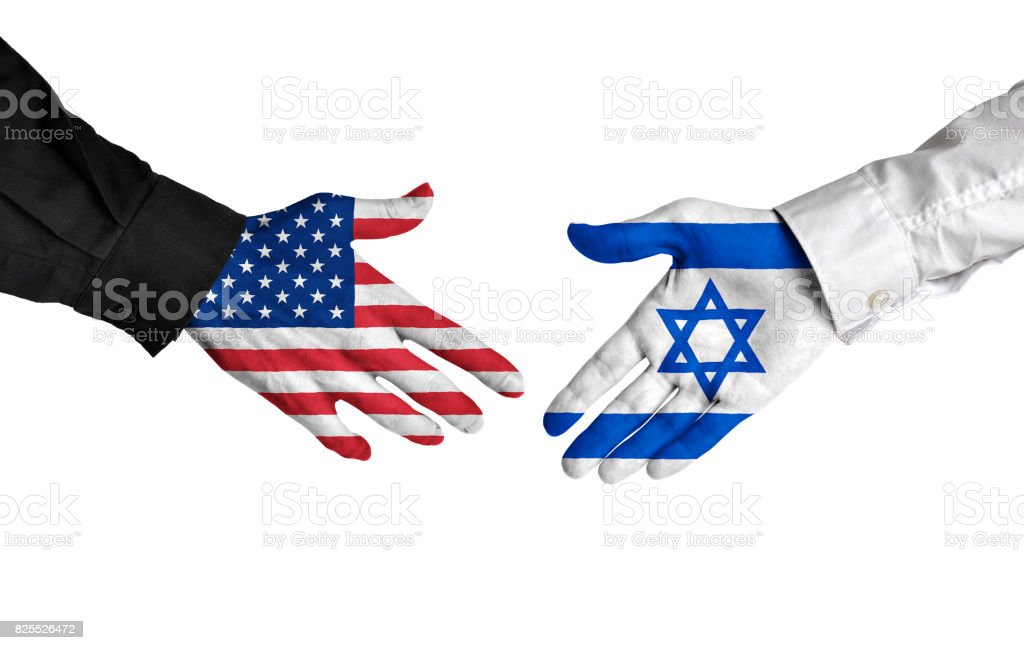 United States and Israel leaders shaking hands on a deal agreement stock photo