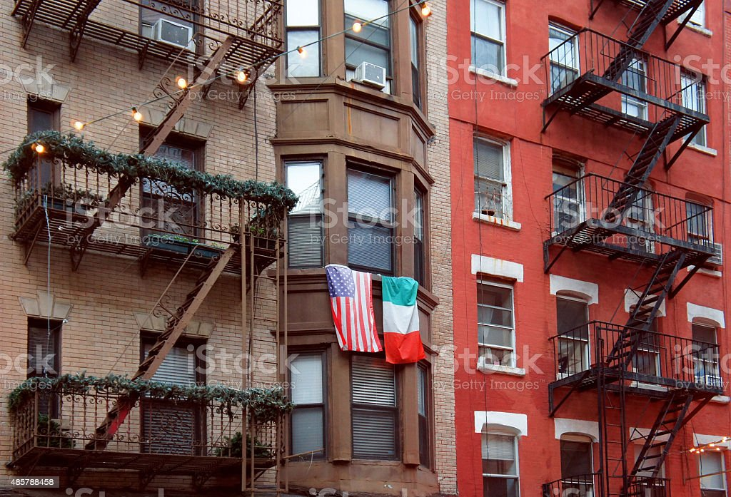 United States and Italy flags at the balcony in Little Italy stock photo